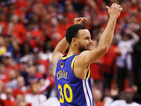 Golden State Warrior Stephen Curry celebrates during Game Five of the 2019 NBA Finals against the Toronto Raptors.