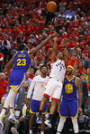 Toronto Raptor Kyle Lowry attempts a last-second shot during Game Five of the 2019 NBA Finals against the Golden State Warriors.