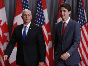 Prime Minister Justin Trudeau and U.S. Vice-President Mike Pence leave following a news conference in Ottawa on May 30, 2019.