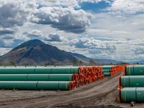 Steel pipe to be used in the construction of the Trans Mountain pipeline expansion lies at a stockpile site in Kamloops, B.C., on June 18, 2019.
