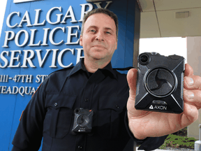 Calgary Police Service Staff Sgt. Travis Baker shows the service's new Axon body camera on July 3, 2018. Calgary's police force is one of the few in Canada to use the technology.