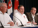 Alberta Premier Jason Kenney, centre, with Ontario Premier Doug Ford and Saskatchewan Premier Scott Moe on July 8. His promise to cut trade regulations comes amid a gathering of all 13 provincial and territorial premiers this week in Saskatoon.