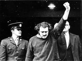 FLQ terrorist Paul Rose, one of the most notorious figures of the 1970 October Crisis, gives a defiant salute as he arrives for a court appearance on Jan. 7, 1971.