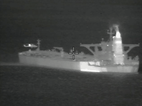 A helicopter hovers near the Iranian oil tanker Grace 1 off Gibraltar, in a night vision photograph released July 4, 2019.