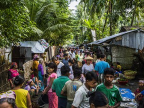 Buddhists and Muslims in a market in the village of Sin Tet Maw in Myanmar's Rakhine State, Sept. 10, 2018. With ethnic conflict spreading in Rakhine State in Myanmar, a government-led online shutdown could hide human rights abuses and leave vulnerable populations in the dark.