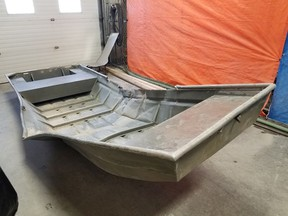 A damaged aluminum boat, recovered from the shores of the Nelson River police searching for fugitive murder suspects Kam McLeod and Bryer Schmegelsky, is seen on August 4, 2019.  .