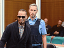 Accused Islamic State member Abdelkarim El B. arrives for the first day of his trial in Frankfurt, Germany, Aug. 22, 2016.
