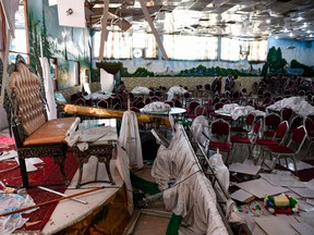 Afghan men investigate in a wedding hall after a deadly bomb blast in Kabul on Aug. 18, 2019. More than 60 people were killed and scores wounded in an explosion targeting a wedding in the Afghan capital, authorities said on Aug. 18, the deadliest attack in Kabul in recent months.