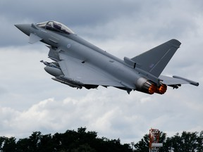 A Eurofighter Typhoon fighter jet performs a flying display on the second day of the Farnborough International Airshow 2016 in Farnborough, U.K., on Tuesday, July 12, 2016.