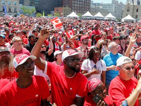 Canadians celebrate during Canada Day festivities on Parliament Hill in Ottawa, Ontario.