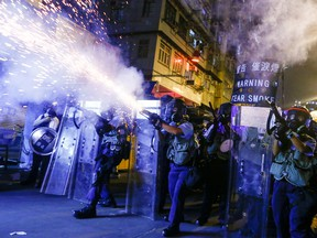 Police fire tear gas at anti-extradition bill protesters during clashes in Sham Shui Po in Hong Kong, China, August 14, 2019.