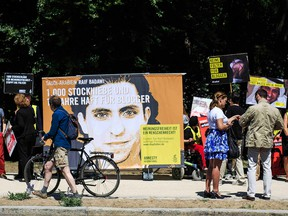 Activists demonstrate outside the Saudi Arabian Embassy against the recent Saudi court ruling that upheld a previous verdict of ten years in prison and 1,000 lashes for Saudi blogger Raif Badawi on June 11, 2015 in Berlin, Germany.