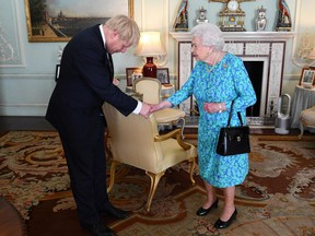 Britain's Queen Elizabeth II welcomes Boris Johnson in Buckingham Palace, London on July 24, 2019, where she invited him to become Prime Minister and form a new government.