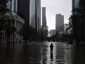 A man stands in a flooded street as Hurricane Irma hits Miami on Sept. 10, 2017.