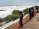 People check out the ocean waves as Hurricane Dorian continues to head toward the Florida coast  on Sept. 2, 2019 in West Palm Beach, Florida.