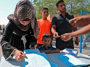 Bedouins from the Negev register to vote outside a polling station in Beersheva in southern Israel during the Jewish state's parliamentary election on September 17, 2019.