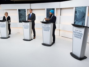A empty podium stand where Liberal Leader Justin Trudeau turned down the invitation for the debate as Green Party Leader Elizabeth May, left, Conservative Leader Andrew Scheer, centre, and NDP Leader Jagmeet Singh take part during the Maclean's/Citytv National Leaders Debate in Toronto on Thursday, September 12, 2019.