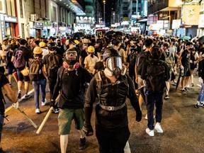 Protesters prepare to clash with police outside the Mongkok Police Station on September 6, 2019 in Hong Kong, China.