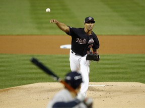 Joe Ross #41 of the Washington Nationals delivers the pitch against the Houston Astros during the first inning in Game Five of the 2019 World Series at Nationals Park on October 27, 2019 in Washington, D.C.
