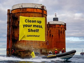 Greenpeace activists hung banners saying, 'Shell, clean up your mess!' and 'Stop Ocean Pollution' in a peaceful protest against plans by the company to leave parts of old oil structures with 11,000 tons of oil in the North Sea.