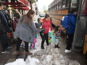 Evacuated families from the Lake Manitoba First Nation load their belongings onto a bus outside a hotel in Winnipeg, Monday October 14, 2019.