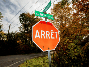 A street sign at Roxham Road near the U.S. and Canada border in Quebec. The number of people walking into Canada and seeking asylum, though down from the historic heights of two years ago, remains high.