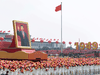 A float with a giant portrait of China's President Xi Jinping passes by Tiananmen Square in Beijing on Oct. 1, 2019, to mark the 70th anniversary of the founding of the People's Republic of China.