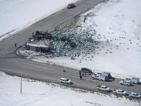The wreckage of the Humboldt Broncos hockey bus crash is shown outside of Tisdale, Sask., on Saturday, April, 7, 2018. Several families affected by the deadly Humboldt Broncos hockey bus crash say they are upset by an Alberta review into its trucking regulations.