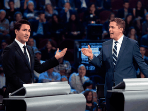 Liberal Leader Justin Trudeau and Conservative Leader Andrew Scheer during the Federal Leaders Debate in Gatineau, Quebec on Oct. 7, 2019.