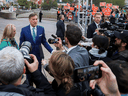People's Party of Canada Leader Maxime Bernier talks to reporters as he arrives for a federal leaders' debate on Oct. 7, 2019.
