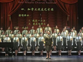 Singers dressed in the uniform of China's People Liberation Army perform at a concert in Richmond Hill, Ont.