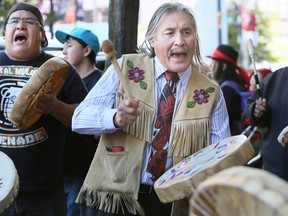 Chief Martin Louie  from the Nordleh Whuten First Nation, located in central BC, joined drummers as they sang traditional songs outside a meeting regarding the Enbridge pipeline on September 11, 2014.