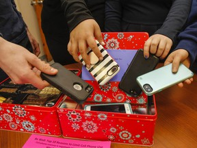Frontenac Secondary School students put their cellphones away in the schools new classroom tins, initiated in March 2018, to help students detach from the cellphones during class time.
