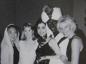 "Canada's Prime Minister Justin Trudeau, with his face and hands painted brown, poses with others during an ""Arabian Nights"" party when he was a 29-year-old teacher at the West Point Grey Academy in Vancouver, Canada, in this photo published in the academy's 2000-2001 yearbook."