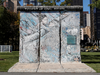 A portion of the Berlin Wall stands in the garden of the United Nations headquarters in New York.