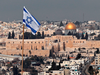 An Israeli flag flies on the roof of a building in East Jerusalem.