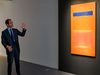 """An art expert from Sotheby's talks about Mark Rothko's """"Blue Over Red"""" during an auction preview Nov. 1, 2019 at Sotheby's in New York."""