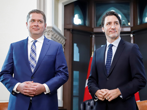 Conservative Leader Andrew Scheer, left, meets with Prime Minister Justin Trudeau on Parliament Hill in Ottawa on Nov. 12, 2019.