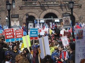 Thousands of teachers, students and unionists  protest funding cuts to Ontario's education system on the front lawn of the provincial legislature on April 6, 2019.