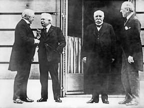 Left to right: British Prime Minister Lloyd George, Italian Council President Vittorio Orlando, French council President Georges Clemenceau and U.S. President Woodrow Wilson attending the opening day of the Conference for Peace in Paris on Jan. 19, 1919.