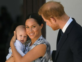 Britain's Prince Harry and his wife Meghan, Duchess of Sussex, holding their son Archie.