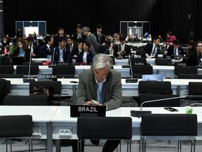 Delegates wait for the start of the closing plenary session of the UN Climate Change Conference COP25 at the 'IFEMA - Feria de Madrid' exhibition centre, in Madrid, on Dec. 15, 2019.