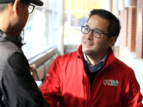 Ontario Liberal leadership candidate Alvin Tedjo speaks with a visitor to the Riverside Branch of the Windsor Public Library on Nov. 7, 2019.
