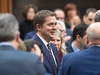 Conservative MP's pay their respects to Andrew Scheer following his announcement he will step down as leader of the Conservatives, Dec. 12, 2019 in the House of Commons.