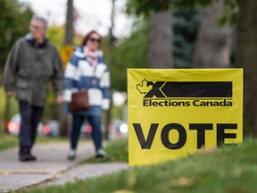 In a file photo from Oct. 21, 2019, voters arrive at a polling station in Mississauga, Ont., to cast a ballot in the past federal election.