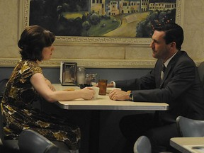 """Elisabeth Moss and Jon Hamm as Peggy and Don in Mad Men's """"The Suitcase."""""""