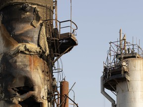 A damaged refining tower stands during repair at Saudi Aramco's Abqaiq crude oil processing plant following a drone attack in Abqaiq, Saudi Arabia
