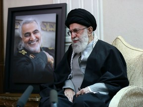 A handout picture provided by the office of Iran's Supreme Leader Ayatollah Ali Khamenei on January 3, 2020, shows him  visiting the family of killed Iranian Revolutional Guards commander Qasem Soleimani (picture), in the capital Tehran.