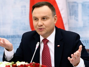 Poland's President Andrzej Duda gestures as he gives a press conference with the Lithuanian President following talks in Vilnius on February 17, 2018.