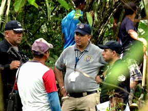 Grab taken from Panamanian channel TVN Noticias showing Panamanian police and employees of the Public Ministry near the site where a mass grave was found with seven bodies at the indigenous region of Ngabe Bugle, in Bocas del Toro province, Panama, on January 15, 2020.